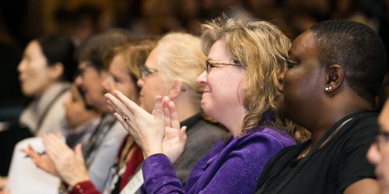 Conference attendees clapping